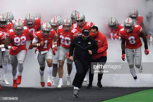 Head Coach Ryan Day of the Ohio State Buckeyes leads his team on to the field for a game against the Indiana Hoosiers at Ohio Stadium on November 21,...