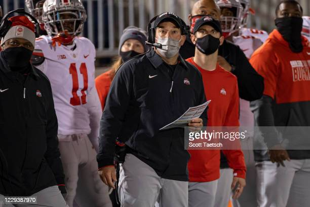 Head coach Ryan Day of the Ohio State Buckeyes looks on during the first half of the game against the Penn State Nittany Lions at Beaver Stadium on...