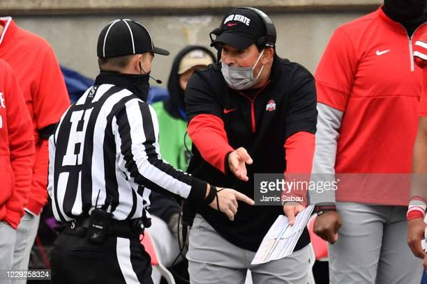 Head coach Ryan Day of the Ohio State Buckeyes talks with a referee in the second quarter against the Nebraska Cornhuskers at Ohio Stadium on October...