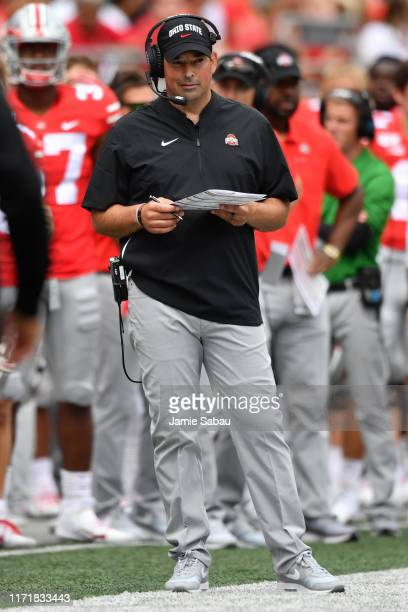 Head Coach Ryan Day of the Ohio State Buckeyes watches his team play against the Florida Atlantic Owls at Ohio Stadium on August 31 2019 in Columbus...