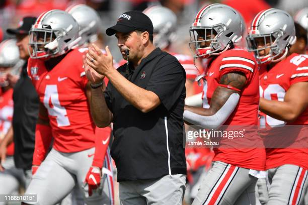 Head Coach Ryan Day of the Ohio State Buckeyes watches his team warm up before a game against the Cincinnati Bearcats at Ohio Stadium on September 7...