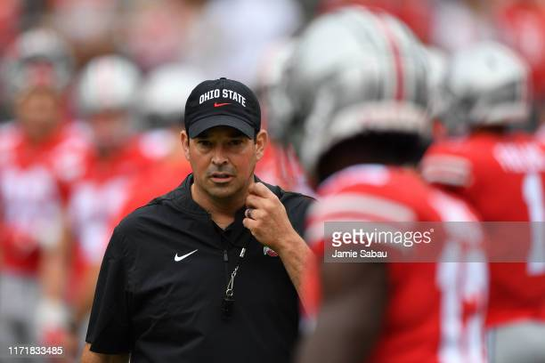 Head Coach Ryan Day of the Ohio State Buckeyes watches his team warm up before a game against the Florida Atlantic Owls at Ohio Stadium on August 31...