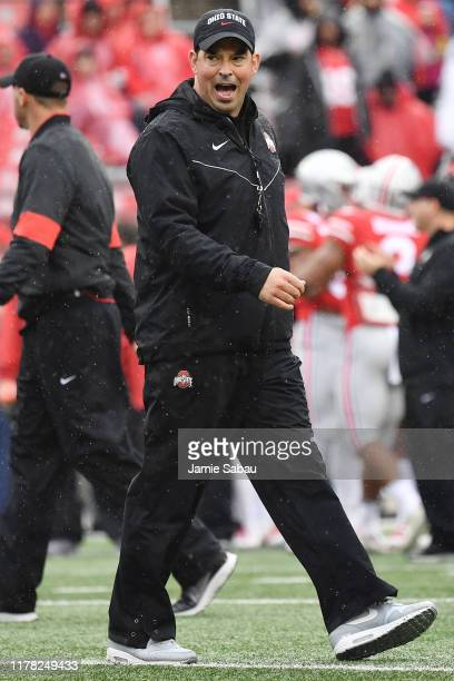 Head coach Ryan Day of the Ohio State Buckeyes watches his team warm up prior to a game against the Wisconsin Badgers at Ohio Stadium on October 26...