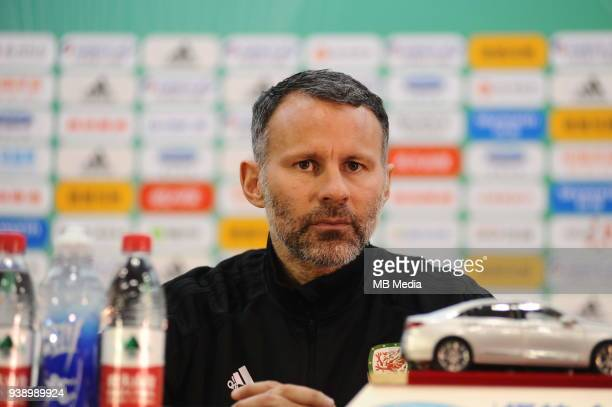 Head coach Ryan Giggs of Wales national football team attends a press conference after the final match against Uruguay national football team during...