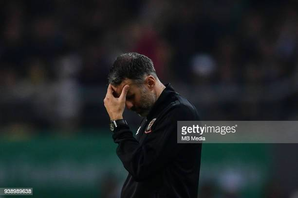 Head coach Ryan Giggs of Wales national football team reacts as he watches his players competing against Uruguay national football team in their...
