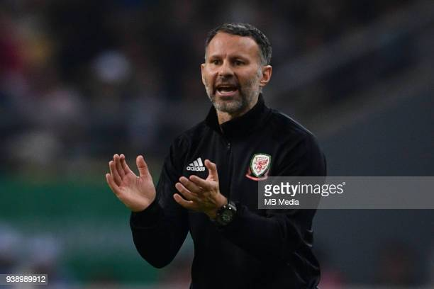 Head coach Ryan Giggs of Wales national football team shouts instructions to his players as they compete against Uruguay national football team in...