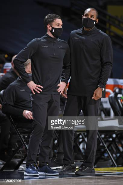 Head Coach Ryan Saunders and Assistant Coach David Vanterpool of the Minnesota Timberwolves talk during the game against the Denver Nuggets on...