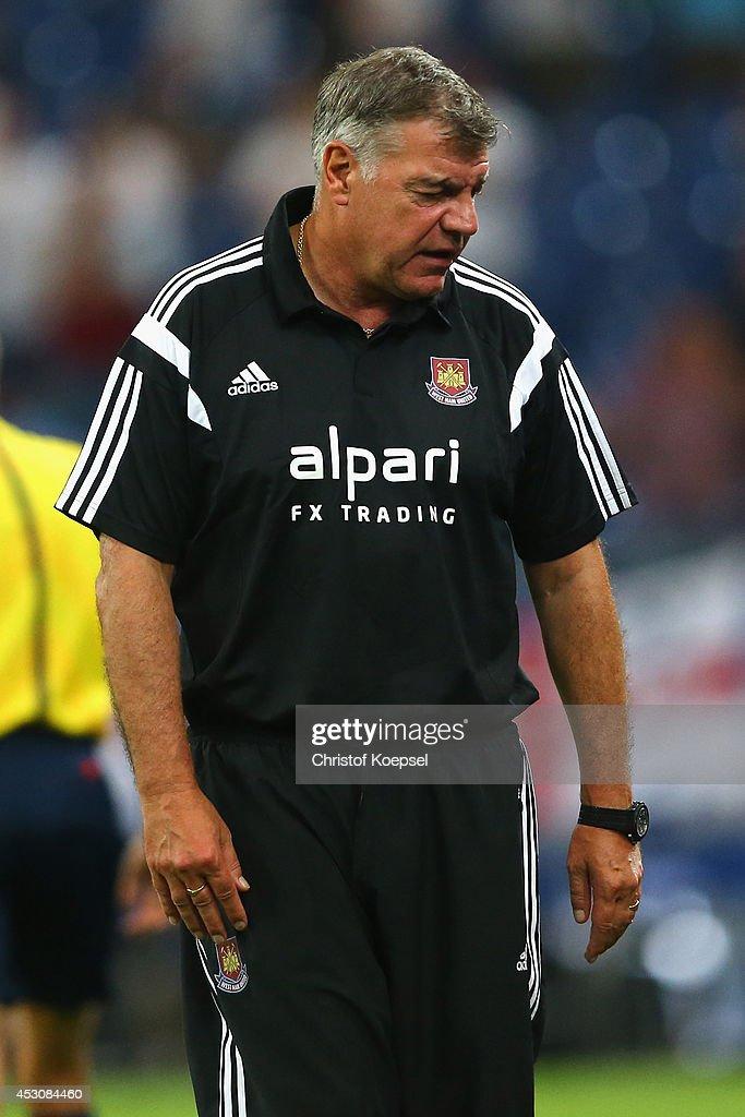 Head coach Sam Allardyce of West Ham United looks dejected during the match between FC Schalke 04 and West Ham United as part of the Schalke 04 Cup Day at Veltins-Arena on August 2, 2014 in Gelsenkirchen, Germany.