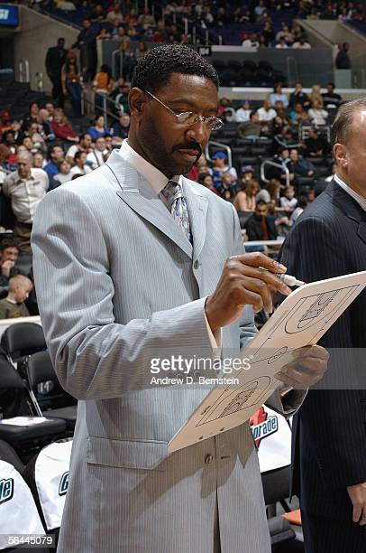 Head coach Sam Mitchell of the Toronto Raptors goes over plays on a clipboard during a game against the Los Angeles Clippers on November 23 2005 at...