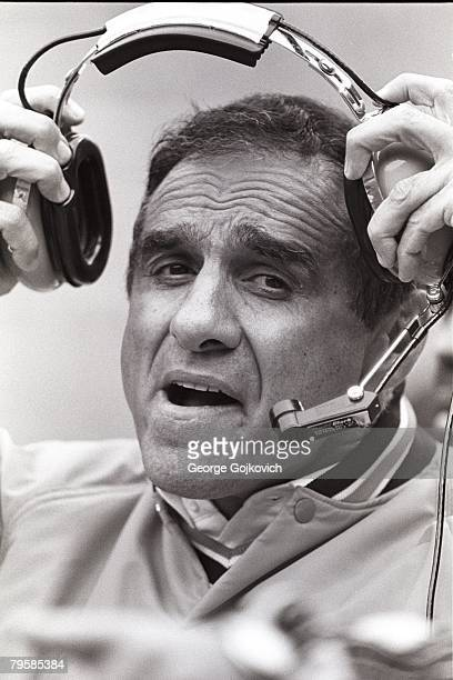 Head coach Sam Rutigliano of the Cleveland Browns removes his headset during a game against the New York Jets at Municipal Stadium on October 14 1984...
