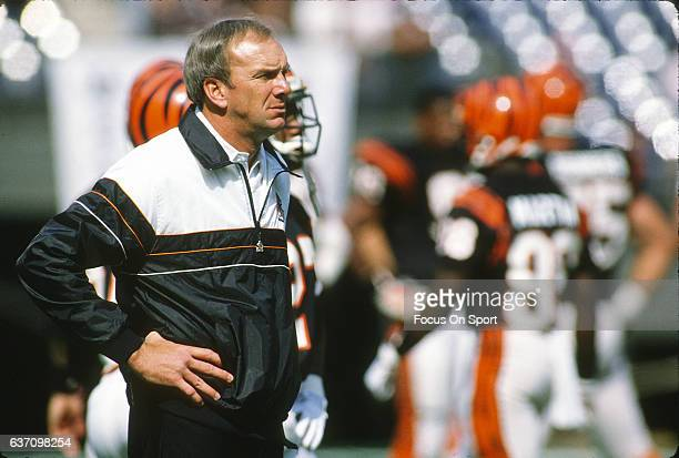 Head coach Sam Wyche of the Cincinnati Bengals looks on during pregame warm ups prior to the start of an NFL football game circa 1989 at Riverfront...