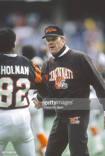 Head coach Sam Wyche of the Cincinnati Bengals shakes the hand of Rodney Holman during pregame warm ups prior to the start of an NFL football game...