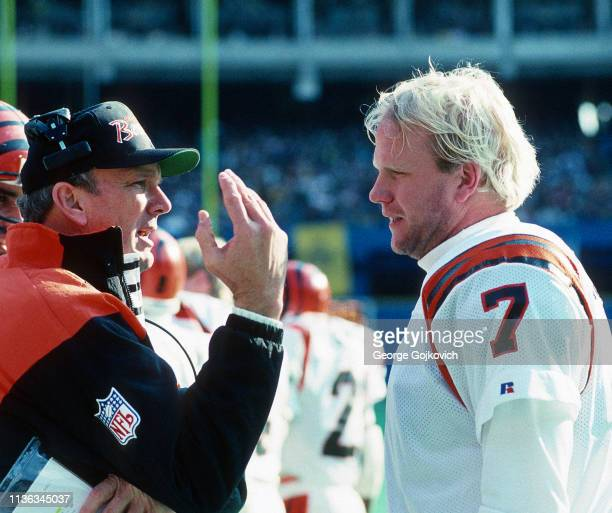 Head coach Sam Wyche of the Cincinnati Bengals talks to quarterback Boomer Esiason during a game against the Pittsburgh Steelers at Three Rivers...