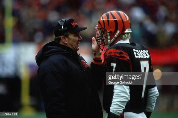 Head coach Sam Wyche of the Cincinnati Bengals talks with quarterback Boomer Esiason on the sideline during the AFC Championship game at Riverfront...