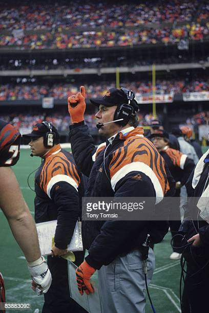 Head coach Sam Wyche of the Cincinnati Bengals watches the action from the sidelines during a game on December 23 1990 against the Houston Oilers at...