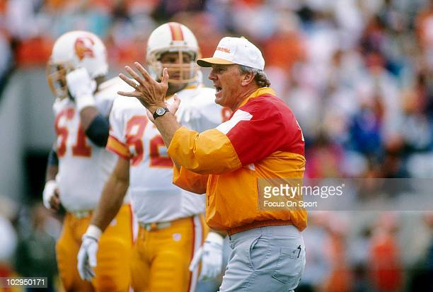 Head Coach Sam Wyche of the Tampa Bay Buccaneers in this portrait watching his team warmup circa 1993 before an NFL football game Wyche was head...