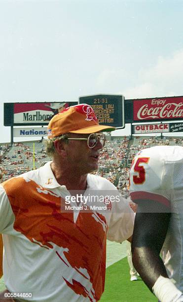 Head Coach Sam Wyche of the Tampa Bay Buccaneers prepares to start a NFL football game against the Washington Redskins at Tampa Stadium on September...