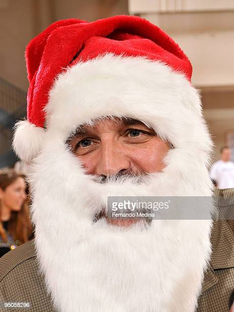Head coach 'Santa' Stan Van Gundy of Orlando Magic looks on during a holiday party for 42 families from Apopka Family Learning Center at the RDV...