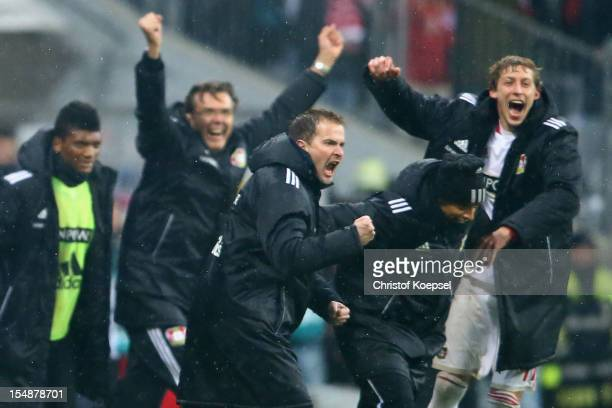 Head coach Sascha Lewandowski and Stefan Kiessling of Leverkusen celebrate the 21 victory after the Bundesliga match between FC Bayern Muenchen and...
