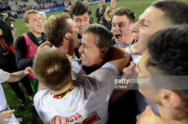 Head Coach Sasho Cirovski of the Maryland Terrapins celebrates with his team after defeating the Akron Zips during the Division I Men's Soccer...