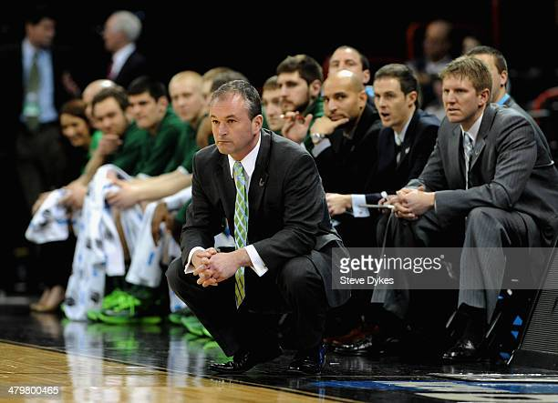 Head coach Saul Phillips of the North Dakota State Bison watches his team during the second round of the 2014 NCAA Men's Basketball Tournament...