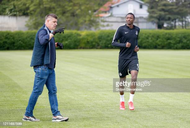 Head coach Savo Milosevic of FK Partizan speaks to Umar Sadiq during the FK Partizan first training session since the corona crisis started at...