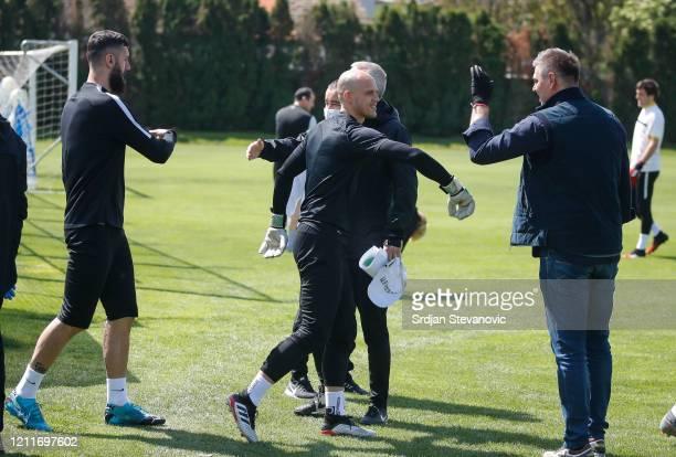 Head coach Savo Milosevic of FK Partizan welcomes the players goalkeeper Nemanja Stevanovic and Aleksandar Scekic during the FK Partizan first...
