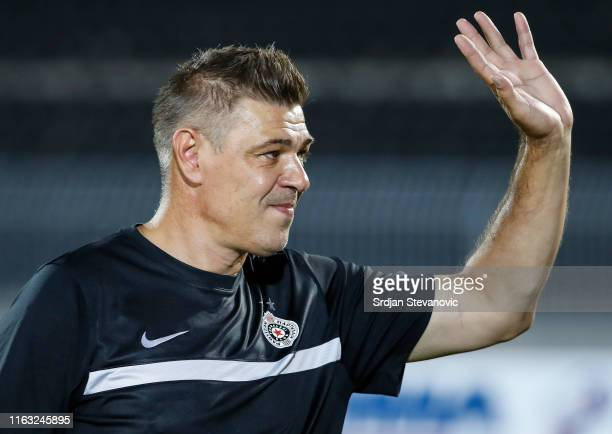 Head coach Savo Milosevic of Partizan applauds fans prior to the UEFA Europa League Play Off First Leg match between Partizan Belgrade and Molde at...