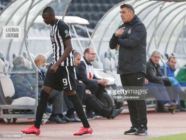 Head coach Savo Milosevic of Partizan speaks to Umar Sadiq during the Serbian Super League match between FK Partizan and FK Mladost Lucani on May 30,...