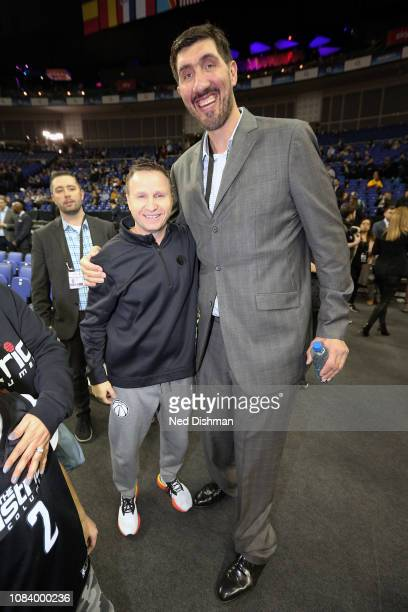 Head Coach Scott Brooks of the Washington Wizards poses for a photo with former NBA player Gheorghe Muresan before the 2019 NBA London Game against...