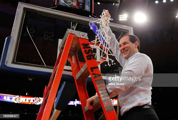 Head coach Scott Drew of the Baylor Bears celebrates after defeating the Iowa Hawkeyes during the 2013 NIT Championship at Madison Square Garden on...