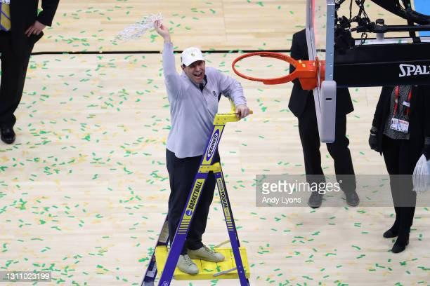 Head coach Scott Drew of the Baylor Bears cuts down the nets after defeating the Gonzaga Bulldogs in the National Championship game of the 2021 NCAA...