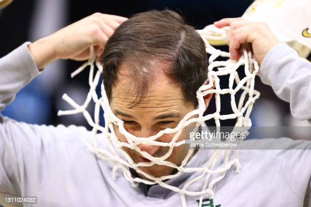 Head coach Scott Drew of the Baylor Bears places the net around his neck after their win against the Gonzaga Bulldogs in the National Championship...