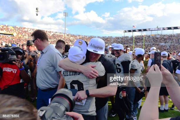 Head coach Scott Frost embraces running back Adrian Killins Jr #9 of the UCF Knights after winning the ACC Championship against the Memphis Tigers...