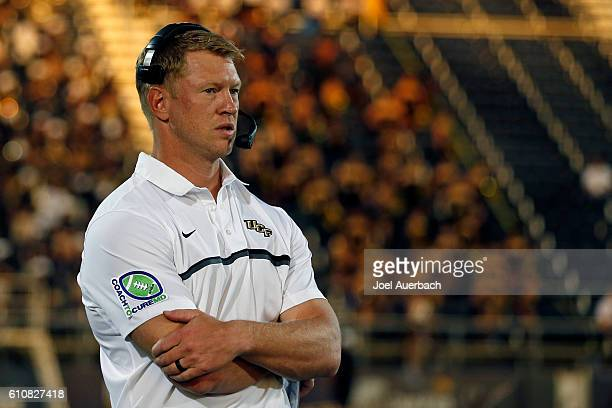 Head coach Scott Frost of the Central Florida Knights watches first quarter action against the Florida International Golden Panthers on September 24...