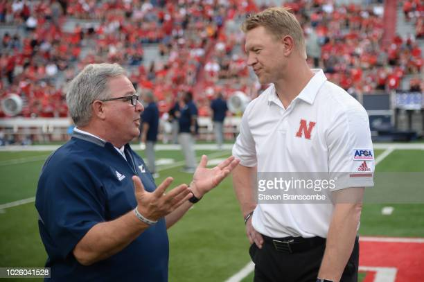 Head coach Scott Frost of the Nebraska Cornhuskers and head coach Terry Bowden of the Akron Zips meet before the game at Memorial Stadium on...
