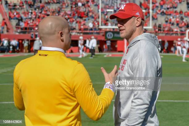 Head coach Scott Frost of the Nebraska Cornhuskers and head coach PJ Fleck of the Minnesota Golden Gophers meet before the game at Memorial Stadium...