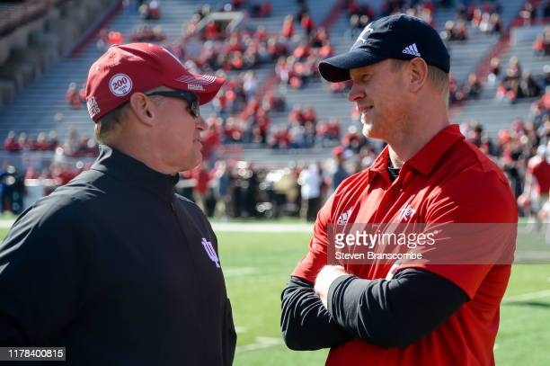 Head coach Scott Frost of the Nebraska Cornhuskers and head coach Tom Allen of the Indiana Hoosiers talk before the game at Memorial Stadium on...
