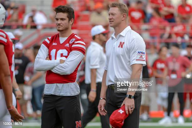Head coach Scott Frost of the Nebraska Cornhuskers and quarterback Noah Vedral watch pregame warmups before the game against the Akron Zips at...