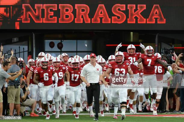 Head coach Scott Frost of the Nebraska Cornhuskers leads the team on the field before the game against the Akron Zips at Memorial Stadium on...