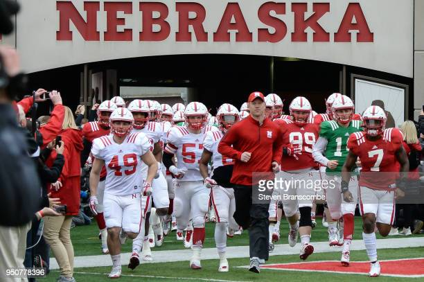 Head Coach Scott Frost of the Nebraska Cornhuskers leads the team on the field before the Spring game at Memorial Stadium on April 21 2018 in Lincoln...