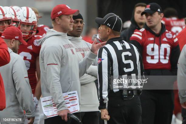 Head coach Scott Frost of the Nebraska Cornhuskers questions a call with an official in the second half of the game against the Purdue Boilermakers...
