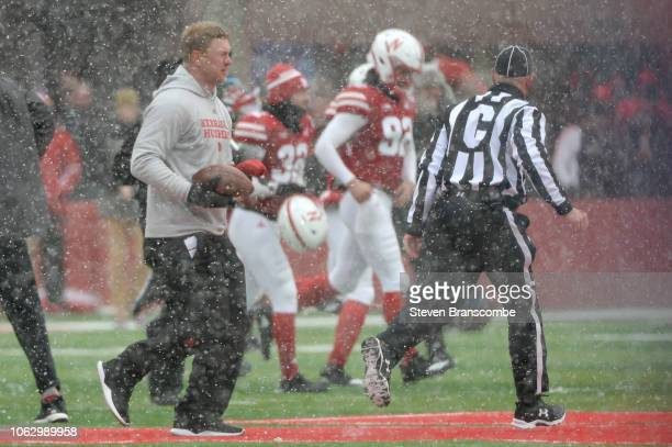 Head coach Scott Frost of the Nebraska Cornhuskers runs to midfield with a game ball after the win against the Michigan State Spartans at Memorial...