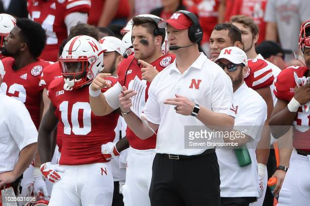 Head coach Scott Frost of the Nebraska Cornhuskers signals plays against the Colorado Buffaloes at Memorial Stadium on September 8 2018 in Lincoln...
