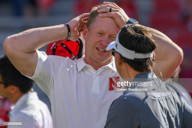 Head coach Scott Frost of the Nebraska Cornhuskers talks with head coach Neal Brown of the Troy Trojans prior to the game at Memorial Stadium on...