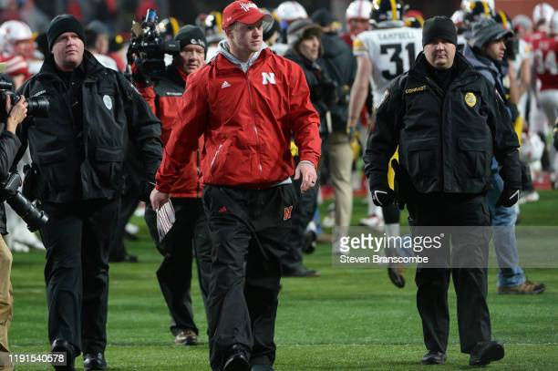Head coach Scott Frost of the Nebraska Cornhuskers walks off the field after the loss against the Iowa Hawkeyes at Memorial Stadium on November 29...