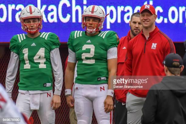 Head Coach Scott Frost of the Nebraska Cornhuskers watches pregame warmups with quarterback Adrian Martinez and quarterback Tristan Gebbia at...