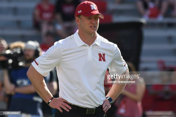 Head coach Scott Frost of the Nebraska Cornhuskers watches the team warm up before the game against the Troy Trojans at Memorial Stadium on September...