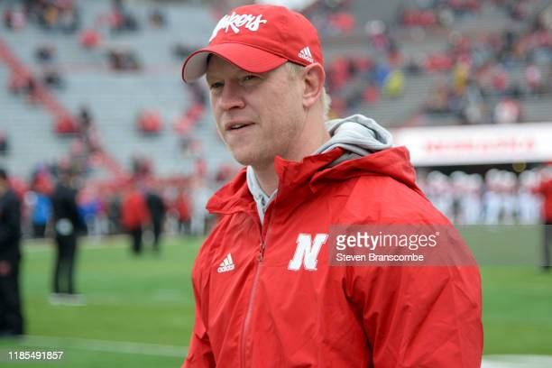 Head coach Scott Frost of the Nebraska Cornhuskers watches the team warm up before the game against the Iowa Hawkeyes at Memorial Stadium on November...