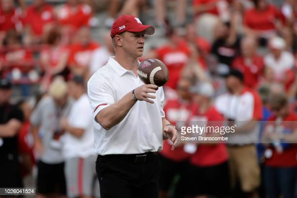 Head coach Scott Frost of the Nebraska Cornhuskers watches warmups before the game against the Akron Zips at Memorial Stadium on September 1 2018 in...